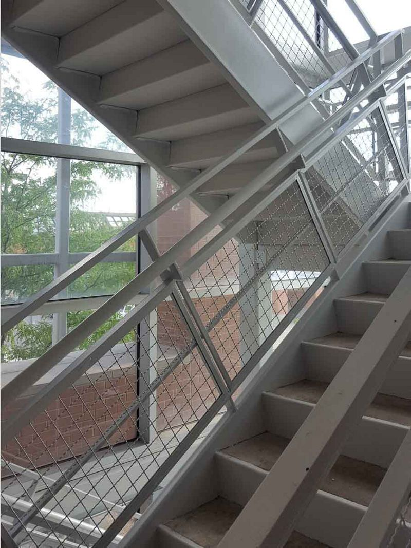 Intercrimp Wire Mesh Infills ensure ultimate security in this staircase railing.