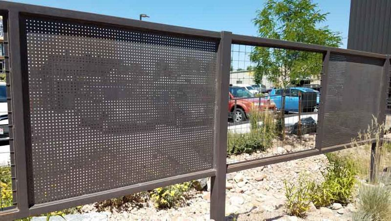 Alternating Perforated Metal and Wire Mesh Infill Panels create a stylish fencing solution.
