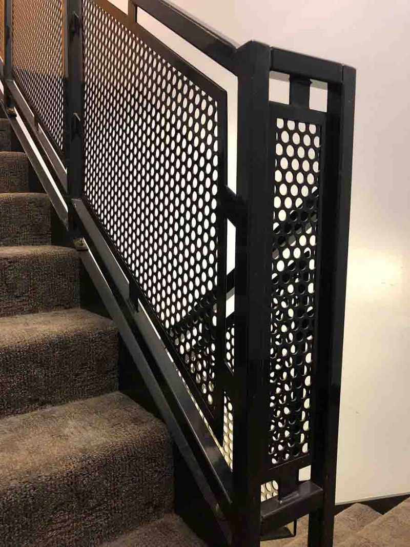 Perforated Metal contributes safety and a modern aesthetic to this staircase railings.