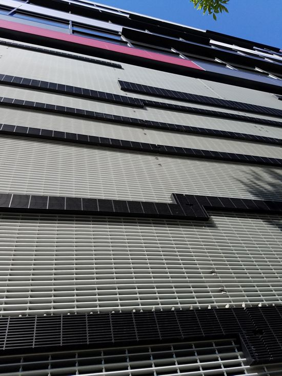 Up close view of McNICHOLS GAL and GCM Bar Grating applied as a building facade on a grocery store in Seattle, WA
