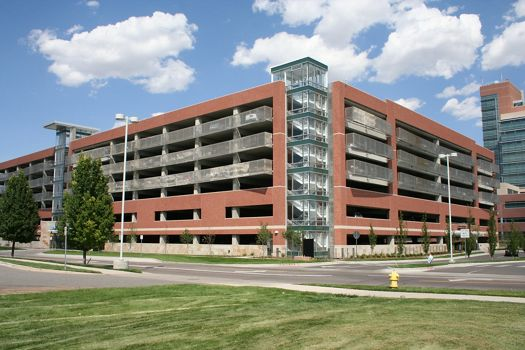 View of an Aurora, CO university parking garage building facade comprised of McNICHOLS Designer Wire Mesh