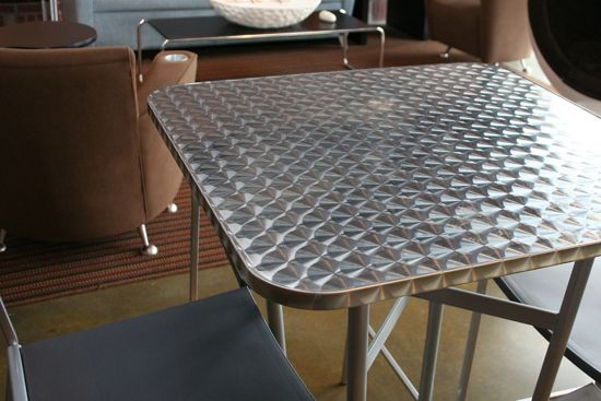 McNICHOLS Designer Textured Metal is used as a table top surface in this St. Petersburg, FL store