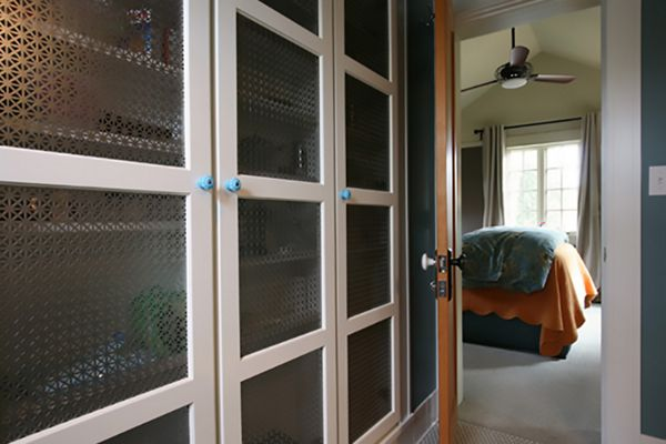 Designer Perforated Metal by McNICHOLS applied as residential cabinet inserts