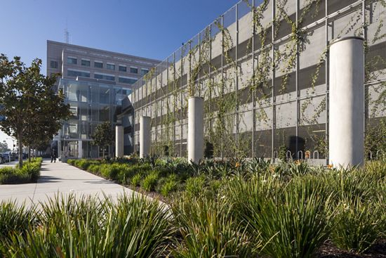 View of ECO-MESH by McNICHOLS applied as a parking garage living wall facade in Long Beach, CA