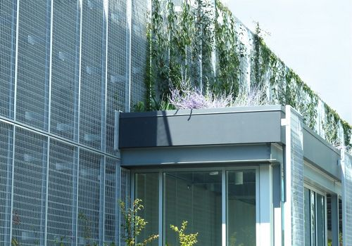 Close up view of McNICHOLS ECO-MESH applied as a living wall building facade at a facility in Seattle, WA