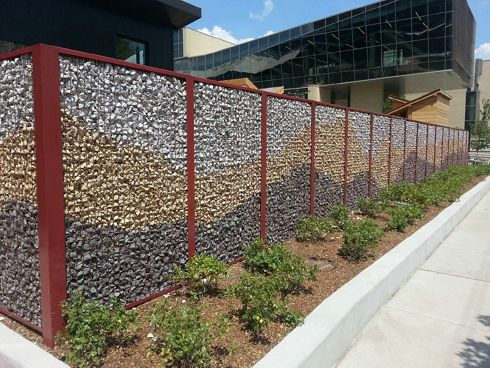 A Chicago, IL child care center shows McNICHOLS ECO-ROCK as a fencing partition