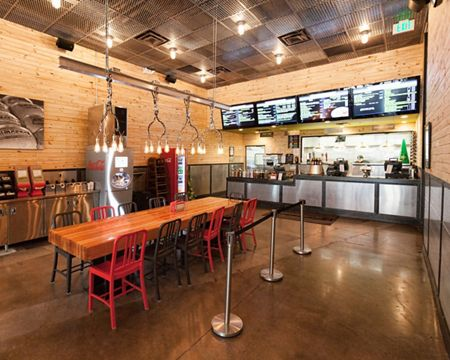 McNICHOLS Expanded and Perforated Metal is used as ceiling tiles and all cladding in this national restaurant franchise