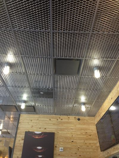 McNICHOLS Expanded Metal functions as decorative ceiling tiles in this national restaurant franchise