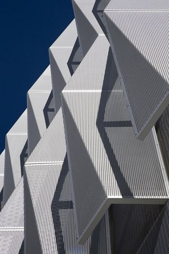 Close up view of McNICHOLS Perforated Metal used as a building facade in Santa Rosa, CA