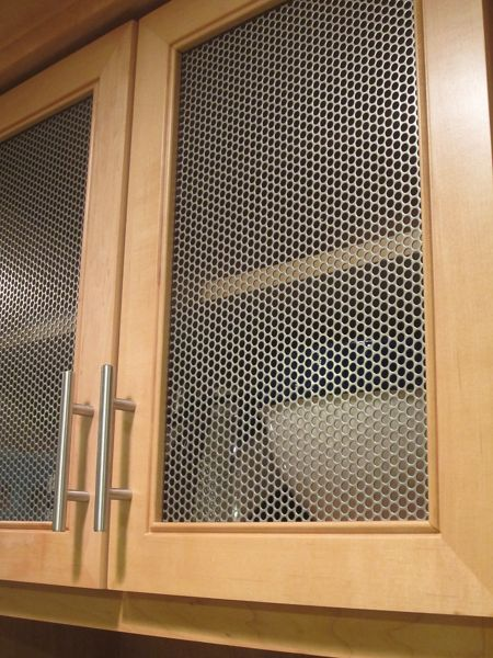 McNICHOLS Round Hole Perforated Metal shown as cabinet inserts in a kitchen in Woodmere, NY