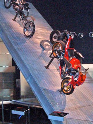 Three motorcycles sitting on an angled panel of Bar Grating