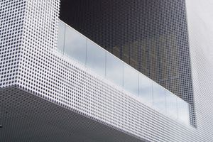 Corner of building covered in Perforated Metal Panels- Small