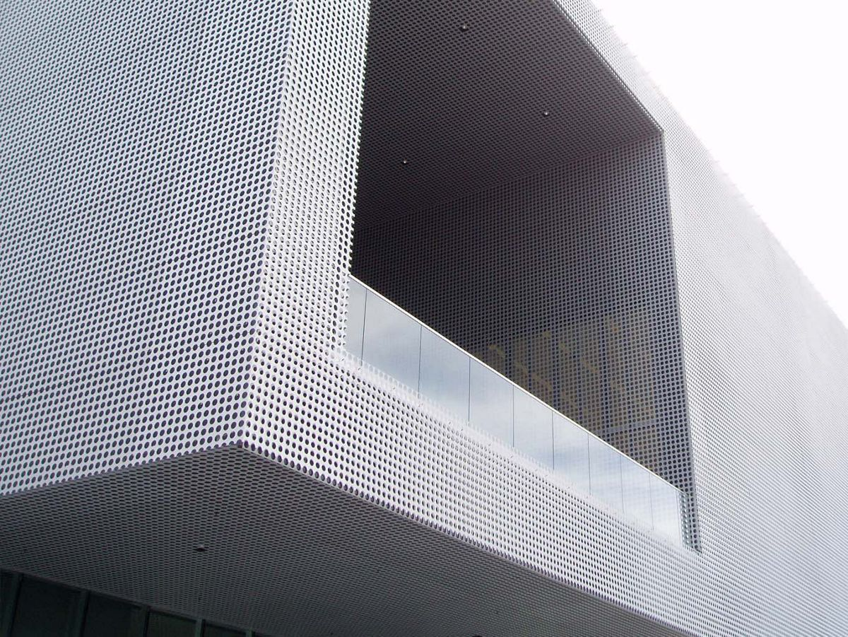 Corner of building covered in Perforated Metal Panels - Large
